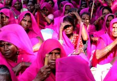 Gulabi Gang - Uttar Pradesh India.  This is an image of the Gulabi (pink) Gang from India. They are a group of women from some of the poorest villages who wear pink saris and train in stick fighting with their leader Sampat Pal. They attack abusive or negligent husbands and corrupt policemen, taking justice directly into their own hands because they are so often ignored by the authorities. They aim to lift women out of helplessness by giving them self defense skills and high self esteem.