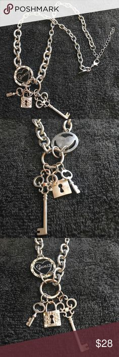 Guess charm necklace This is gently worn and still in beautiful condition. It ha a bit of wear causing the back to look rose in color. Looks very natural and is even unnoticed unless it's turned around. Guess Jewelry Necklaces