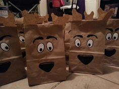 Scooby Doo treat bags. Eyes and eye brows made on paint brush and printed out. Nose drawn on with marker. Ears cut out of extra bags.