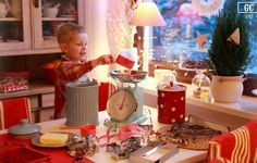 cute Christmas card photo idea--cute measuring cups, a cookie jar, cookie cutters, a tiny chrismast tree, lights in the background and flour on their faces