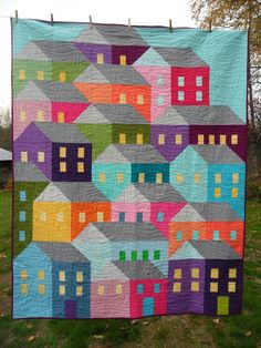 These fun colorful houses were quilted by Cathy from Blueberry Patch using Aurifil 2600. The link for the quilt pattern is in the blog post.  To see more please visit http://cathy-blueberrypatch.blogspot.com/2015_11_01_archive.html