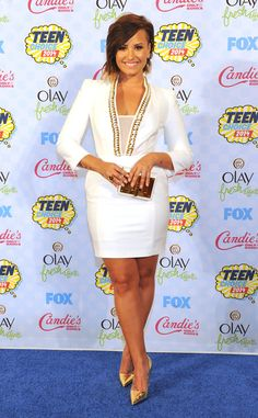 Demi Lovato tries out a more conservative style with this ivory Elisabetta Franch dress. Love it!