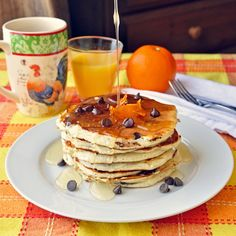 Chocolate Chip Buttermilk Pancakes with Orange Infused Syrup - making your own orange infused syrup to serve with pancakes is very easy and makes any occasion at which you serve these light and fluffy, delicious chocolate chip pancakes just a bit more special.