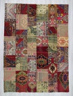 Oversize vintage patchwork rug made from hand-knotted Turkish rug pieces and backed with good quality cotton fabric as reinforcement. In very good condition.