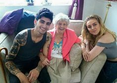 Zayn and Perrie with her grandma!! It's funny because Zayn looks like a total bad boy with his tats and stuff, and yet he is a total softie especially when it comes to family. I mean look, Perries Grandma's arm is around his. He's just, ugh. And his smile.