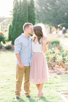 engagement picture at Vander Veer Park in Davenport Iowa taken by Gigi Boucher, an Iowa wedding photographer | posing ideas for engagement pictures | outfit ideas for engagement pictures | pink tulle skirt for engagement pictures