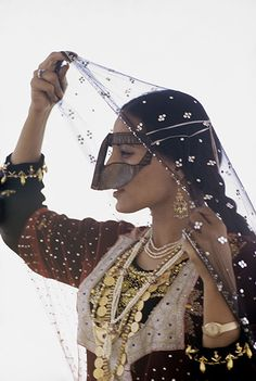 An Emirati woman by Eve Arnold. A still from Arnold's only film, shot in 1971 after being granted privileged access to film wedding preparations for the marriage of Sheikh Maktoum bin Rashid Al-Maktoum. Her production 'Behind the Veil' offered a rare and intimate insight into the Dubai royal court as it recorded the wedding through the eyes of the bride's handmaid, Nora.  An accompanying series of photographs is credited with documenting significant changes in the lives of the region's…