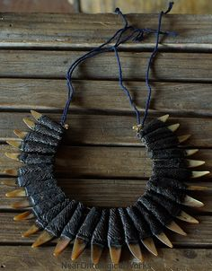 Necklace, Cordillera region, Philippines. |  Necklace of woven rattan and boar's teeth.  Luzon Cordillera is the mountain region situated on the northern part of the Philippine island of Luzon.  Inhabited by various people such as the  Ifugao, Bontoc, Kalinga, Tinguian, Ibaloi, Isneg, Gaddang and Ilongot.