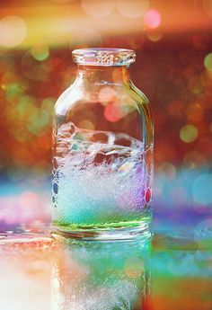 bokeh and bubbles. And rainbow colors. Rainbow Bubbles, Bubble Balloons, Colored Bubbles, Rainbow Glass, Rainbow Light, Magic Bottles, Bottles And Jars, Glass Bottles, Bokeh Photography