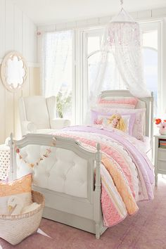 Sun, sea, and mermaids were the inspiration behind the Bailey Bedroom. Set the magic with an upholstered bed, here we used the Blythe Tufted Bed, and our coral version of the Bailey Ruffled Quilted Bedding that features — of course! — mermaids!