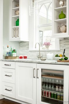 Classic Transitional White | Gorgeous butler's pantry with beautiful window framed by open cabinets. This area is practical and elegant.