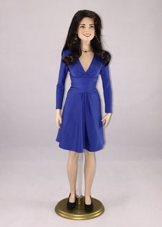 Franklin Mint Kate Middleton doll wearing a version of the Issa dress that Kate Middleton wore for the announcement of her engagement to Prince William.