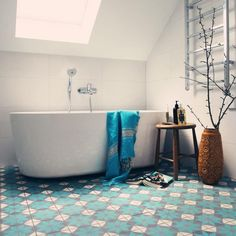 Bathroom design, Minimalist Bathroom Interior Design With Sloping Ceiling Above Bathtub Along With Beautiful Pattern Tile Floor And Metal Towel Ruck On The Wall Along With Handmade Beside Small Wooden Round Table: Alluring Bathroom Design Ideas for Beautiful Bathroom