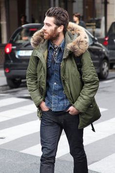 A smart casual combination of an olive parka and charcoal jeans can maintain its relevance in many different circumstances. Shop this look for $162: http://lookastic.com/men/looks/jeans-crew-neck-t-shirt-denim-jacket-scarf-parka/5141 — Charcoal Jeans — Navy Crew-neck T-shirt — Blue Denim Jacket — Navy Print Silk Scarf — Olive Parka
