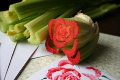 "#crafts #flower #celery #paint  ""Cut celery down to bottom of stalk, dilute red tempera paint with a bit of water, put onto paper plate, dip celery in paint, press onto paper note card, leaving a rose shape! Add leaves and a little message. Perfect project for children and Valentine's Day!!!"""