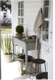 Love the simple, painted potting bench