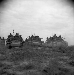 British tanks break through German lines overnight. Valentine tanks carrying infantry of the Black Watch. Tunisia, March 1943.
