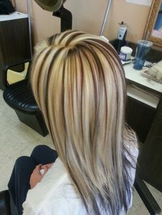 Long straight hair heavily highlighted in white blonde with chocolate brown streaks. More Hair Styles Like This!