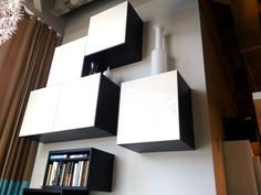high-mounted storage cabinets / boxes; from ikea and part of the entertainment center series; besta or similar series with MANY options for doors/colors