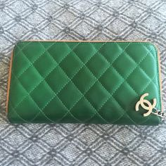 "Chanel Multicolor Limited Edition Lambskin Wallet Chanel Multicolor Limited Edition Lambskin Wallet. Color Green and Orange. Condition Very Good Pre Loved. Disclosure : Minor discoloration of zipper fabric (orange) from rubbing against other fabric or in handbags. On the inside, minor discoloration from credit cards and money. There is also a red mark on inner leather compartment (included in picture). Measurements approx 7.5""x4.5""x1"". 100% leather. Made in Italy. Serial Code 11285791…"
