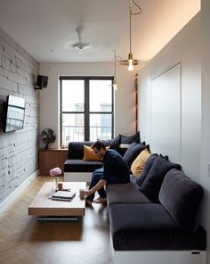 Graham Hill, a sustainability advocate whose TED talks have delved into the benefits of living small, put his own lessons into practice at his 350-square-foot apartment, which he shares with his partner and two dogs. Quick transitions, like drawing the FilzFelt curtain, convert the living space into a bedroom.