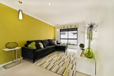 #Living #room #ideas from Ausbuild's Segal display #home.This room is bright and airy with a colour palette of white, black, and green. www.ausbuild.com.au