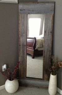 "Barn Wood Mirror  Vertical Size: 56 3/4"" Tall 25"" Wide  In the bedroom, bathroom or even the hallway, this great rustic full length mirror is sure to be a hit. You just need old barn wood or other pieces of wood. Just affix them together around a cheap full length mirror. You can do the same thing with smaller mirrors and hang them all over the house for a really rustic look. Source – Etsy – Sold :("