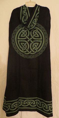 Up for sale is the Black and Green Robe with Celtic Knot Design pictured. The cloak is hooded as you can see. A great item to wear when attending Rituals, Festivals and Renaissance Faires. The beautif
