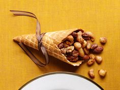 Cone of Plenty : Turn store-bought waffle cones into mini cornucopias: Just fill the cones with spiced nuts and put one at each place setting.