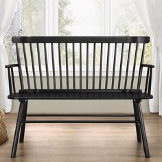 This versatile bench is a great accent piece providing extra seating in any room in the home. Solid wood construction features traditional styling and a modern finish. A classic spindleback design with armrests and shaped seat for comfort.