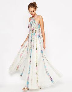 Imagen 69 Vestido largo de malla entallado y de vuelo con estampado floral. Precio 98,99 euros | HISPABODAS