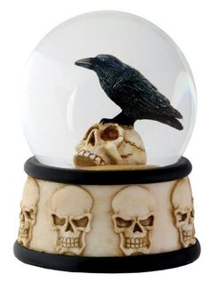 Black Raven on a Skull Skeleton Collectible Water Globe -65mm Collectible Statue Figurine by ytc, http://www.amazon.com/dp/B009AD0RYM/ref=cm_sw_r_pi_dp_eeFHqb13HVBEC
