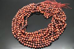 1strand  natural red tiger's eyes plain ball sized 6mm by 3yes