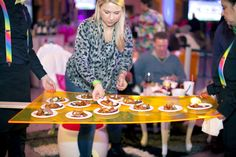 """Chicago production firm Revel Global Events hosted its annual Super Bowl bash at Chicago's Union Station on February 1. To reflect the event's colorful, Katy-Perry-inspired """"Candyland"""" theme, the firm built a custom tray meant to look like a giant popsicle. The tray carried snacks from Limelight Catering.  Photo: Erika DuFour"""