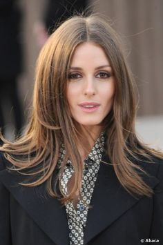 American socialite, model and actress Olivia Palermo wore her hair down in a center part hairstyle at the Burberry Prorsum Womenswear catwa...