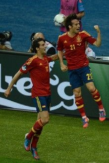 Spanish midfielder David Silva (R) and Spanish defender Alvaro Arbeloa celebrate after scoring during the Euro 2012 football championships final match Spain vs Italy on July 1, 2012 at the Olympic Stadium in Kiev.