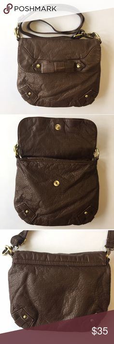 """Urban Outfitters Crossbody Vegan Leather with Bow Urban Outfitters Purse by Kimchi Blue. Retail: $68. Small size (9"""" x 7.5""""). Softest pebbled vegan leather. Dark brown color. Adjustable strap so, it can be worn as a shoulder bag or cross-body. Fold over flap in front with magnetic closure. Zipper pocket inside. Brass metal studs on corners. Decorative bow in front. Fully lined interior. 💎New without tag condition. No flaws. 🛍15% Off Bundles of 2+ Items! B8 Urban Outfitters Bags Crossbody…"""