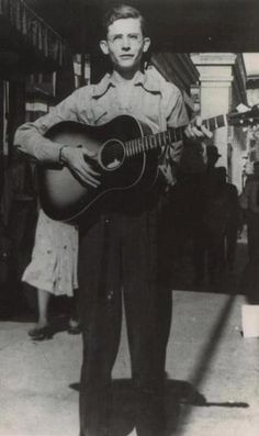 Hank Williams singing on the street in Mobile, AL. at 15 years of age.