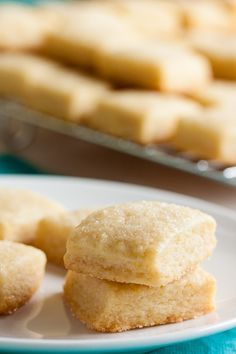This tiny lemon shortbread cookie is soft and tender and buttery. A lovely variation on traditional shortbread. Lemon Desserts, Lemon Recipes, Cookie Desserts, Just Desserts, Cookie Recipes, Delicious Desserts, Dessert Recipes, Biscuit Cookies, Yummy Cookies