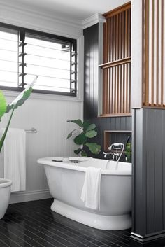 White freestanding bath in grey painted timber floor and panelling bathroom with indoor plants in stunning Brisbane home the combines classic features with a modern feel. Timber Panelling, Timber Flooring, French Oak, Australian Homes, New Builds, Beautiful Bathrooms, Outdoor Pool, Brisbane, Home And Living