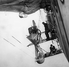 """""""Three members of crew at work on the starboard engine gantry of a Royal Navy Air Service North Sea (N.) type non-rigid airship during an anti-submarine patrol off the British coast circa None. Zeppelin, Steampunk Airship, Dieselpunk, Steampunk Design, Vintage Airplanes, World War One, Royal Navy, Military History, Military Aircraft"""