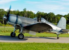 FG-1D Corsair on the way to runway.