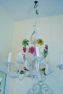 She repainted her chandelier. I wonder if there's any amount of paint that would make mine something I like.