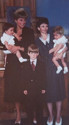 1991: Prince Harry and Lady Diana photographed with Fay Appleby, Lady Di's dresser and her twin sons.