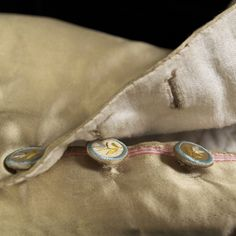 Detail of buttons on breeches, KSUM 1983.1.22 a-c