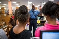 Capt. Ronald S. Johnson of the Highway Patrol visited students taking part in a program at the library in Ferguson. RICHARD PERRY / THE NEW YORK TIMES