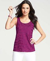Swirl Front Shell - In a covetable twist, this have-to-have flaunts a shimmery, swirled twill ribbon applique for the perfect day-to-night look. Scoop neck. Sleeveless. Scoop back. Applique at front. Solid back.