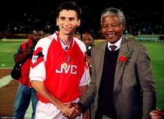 Arsenal striker Alan Smith pictured on the club's 1993 summer tour of South Africa with Nelson Mandela. A year later, Mandela was elected President of the country. During his eight years with Arsenal, Smith scored two of the most important goals in the club's history - the first goal in their 2-0 win at Liverpool which clinched the league title in 1989, and the winner against Parma in the 1994 European Cup-Winners' Cup final in Copenhagen