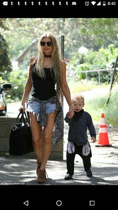 1182ad12a2ed Fergie put her toned legs on full show when she stepped out for a play date  with her son Axl and husband Josh Duhamel in Brentwood on Thursday