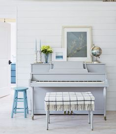 """I'm almost always painting something white, blue, or turquoise,"" Amanda says. Proof: the 1970 piano she painted a soothing gray-blue (Paris Gray by Annie Sloan Chalk Paint) so that it would better blend into the space. Now that the bulk of the home renovation is complete, the family has a new project on the horizon: ""A really awesome fort,"" says Ethan."